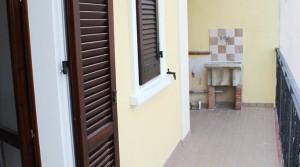 appartamento bilocale in vendita con balcone terrazzo cantina e posto auto a porto potenza picena zona centrale agenzia immobiliare parigi di cruciani stefano 12