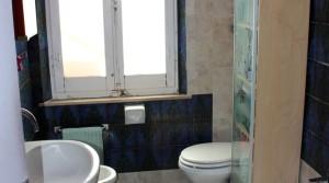 Appartamento piano terra con ingresso indipendente, corte, garage e cantina Porto Potenza Picena centro immobiliare parigi di cruciani stefano 17